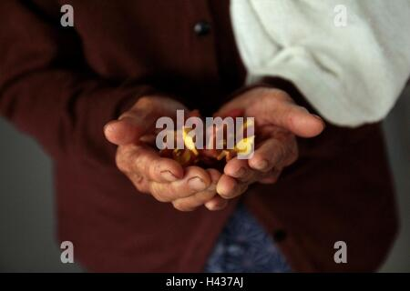 Flower on old woman hand. - Stock Photo