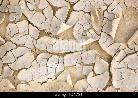 Cracked ground after a drought, large detailed horizontal texture pattern, beige textured background - Stock Photo
