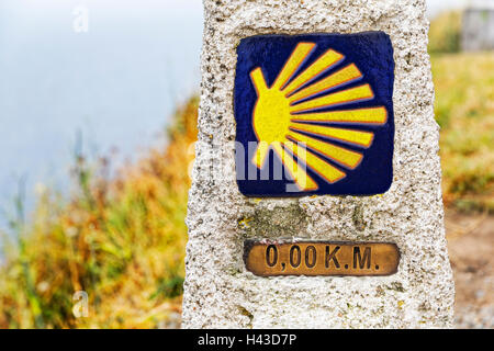 Zero kilometer marker showing the end of the Pilgrimage Camino of Finisterre, final point, Way of St. James, A Coruña - Stock Photo