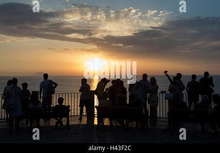 Sunset over Tyrrhenian Sea, observation terrace, Tropea, Calabria, Italy - Stock Photo