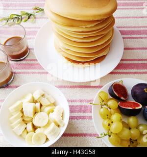 Stack of pancakes with fresh fruit and coffee - Stock Photo