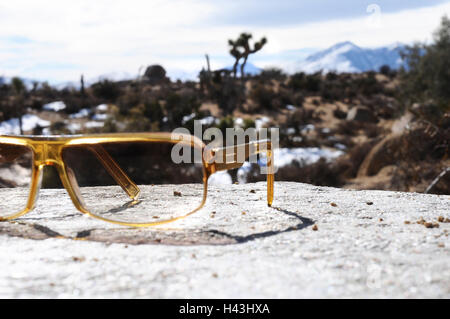 Stone, glasses, lie, forgotten view, scenery, blur, sunglasses, brown, yellow, stone, sunscreen, ocular protection, - Stock Photo