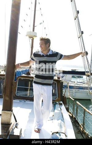 Man, stand young, ship cap, view side view, - Stock Photo