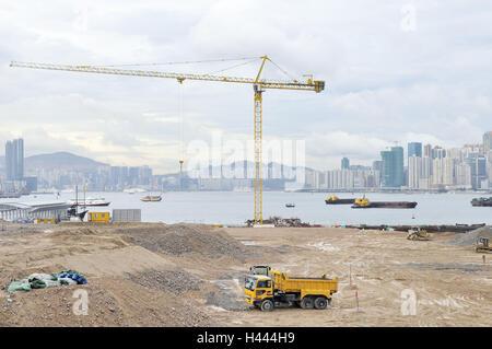 China, Hong Kong, construction site, high rises, men at work, crane, construction machines, - Stock Photo
