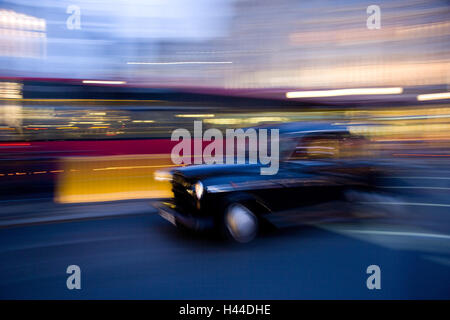 Taxi, Picadilly Circus, blur, London, England, Great Britain, - Stock Photo