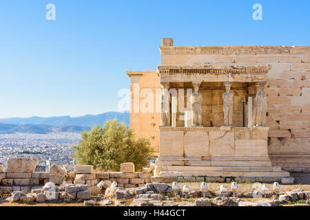 The Porch of the Caryatids and Erechtheion overlooking the city of Athens, Acropolis, Athens, Greece - Stock Photo