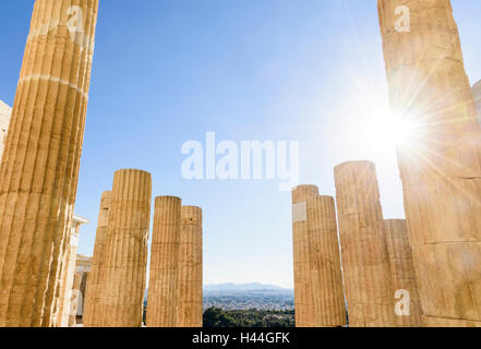 Sun shines through the columns of the Propylaea, the grand entrance to the Acropolis, Athens, Greece - Stock Photo