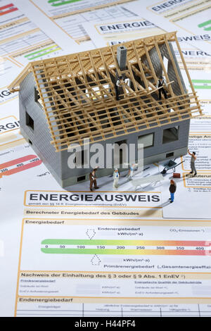 Model house, house under construction, energy identity card, figures, workers, - Stock Photo