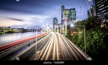 View of the evening traffic rush on the Pacific Motorway going through Brisbane City. - Stock Photo