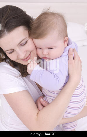 Nut, baby, hold, happily, - Stock Photo