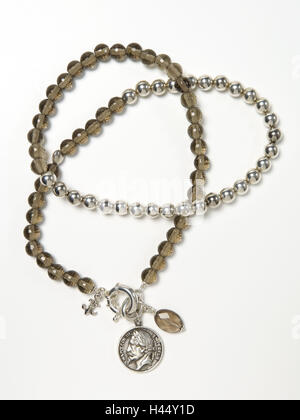 Necklace, glass beads, pendants, antique coin, - Stock Photo