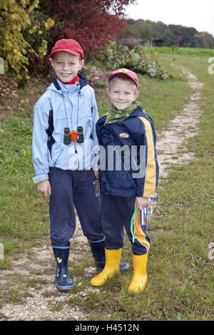 Two boys, 6 and 7 years old, outside, in of a country lane, stand, model released, - Stock Photo