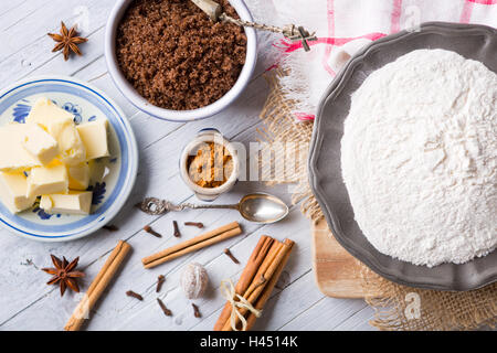 All ingredients for 'pepernoten' or 'kruidnoten', a Dutch delicacy for Dutch holiday 'Sinterklaas'. - Stock Photo