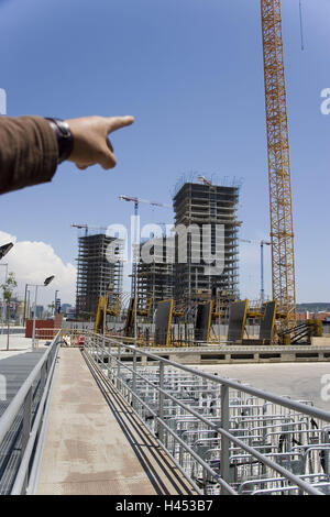 Spain, Barcelona, men at work, high rises, construction cranes, hand, point, new buildings, scaffold, railing, crane, - Stock Photo
