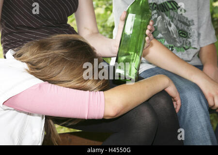 Young persons, girls, boy, sit, hold park-bench, schnapps Bottle, blank, there sleep, drunk, detail, model released, - Stock Photo