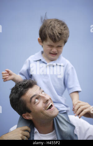 Father, son, shoulders, carrying, looking up, outdoors, portrait, - Stock Photo