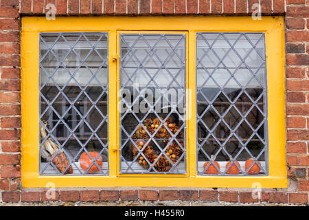 Autumn themed yellow farmed house window. Sussex, England - Stock Photo