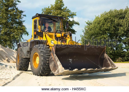 Woman, wheel loaders, happy, laughing, front loaders, Construction Machinery, Girl Power, blonde, leather jacket, - Stock Photo