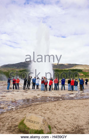 Iceland, Haukadalur, geyser 'Strokkur', eruption, jet, spectators, back view, - Stock Photo