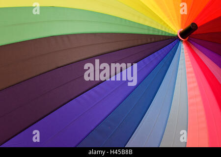 Bright umbrella with rainbow colors close-up - Stock Photo