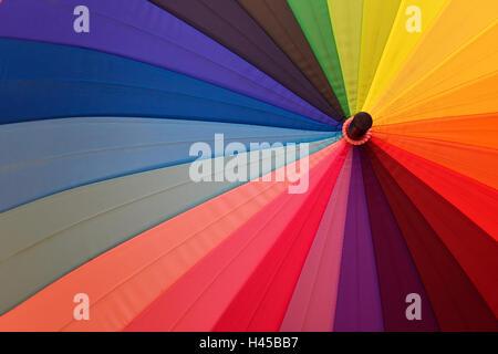 Bright umbrella with rainbow colors close-up - Stock Photo
