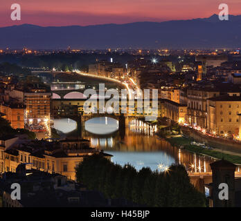The River Arno and the Ponte Vecchio in the city of Florence at night - viewed from Piazzale Michelangelo. - Stock Photo