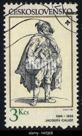 A postage stamp printed in Czechoslovakia  shows Street musician by Jacques Callot , circa 1982 - Stock Photo