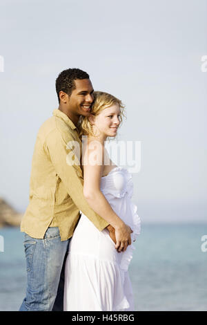 Couple, multicultural, standing, happy, smiling, outdoors, - Stock Photo