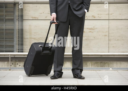 Sidewalk, businessman, trolley, stand, wait, detail, - Stock Photo