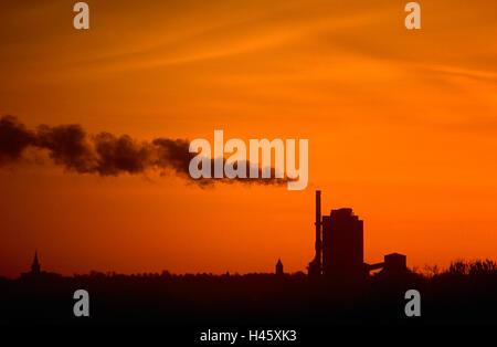 Sunset over industrial plot - Stock Photo
