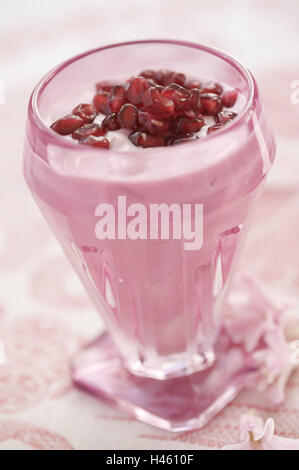 Dessert at pomegranate cores, - Stock Photo