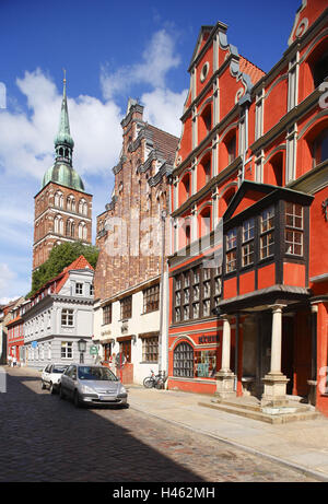 Germany, Mecklenburg-Western Pomerania, Stralsund (city), gabled houses in the old town with St. Nicholas Church, - Stock Photo