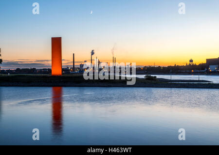 Steel sculpture Rheinorange at river mouth of Ruhr river into the Rhine, Sachtleben chemical plant, Duisburg, Germany - Stock Photo