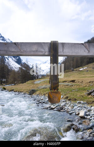 Switzerland, Graubünden, the Engadine, Lower Engadine, Val Susasca, cow bell, mountain brook, - Stock Photo
