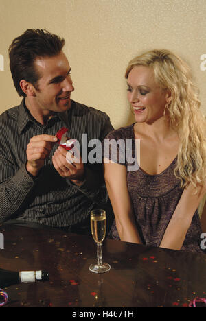 Couple, young, falls in love, man, casket, ring, marriage proposal, woman, happily, half portrait, model released, - Stock Photo