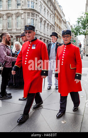 Two Chelsea Pensioners Arrive At The Pearly Kings and Queens' Harvest Festival, The Guildhall Yard, London, England - Stock Photo