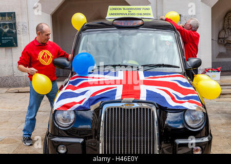 A Black London Taxi and Driver At The Pearly Kings and Queens' Harvest Festival Event In Aid Of A Childrens Charity, - Stock Photo