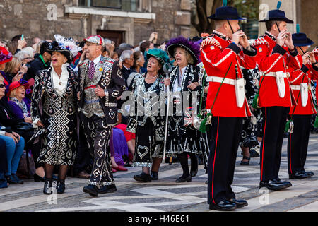 Pearly Kings and Queens Sing Traditional Songs At They Parade Around The Guildhall Yard, Harvest Festival, London, - Stock Photo