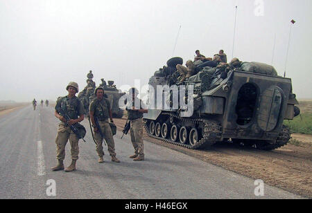 26th April 2003 U.S. Marines standing next to their AAV-P7/A1 amphibious assault vehicles near Diwaniyah in southern - Stock Photo