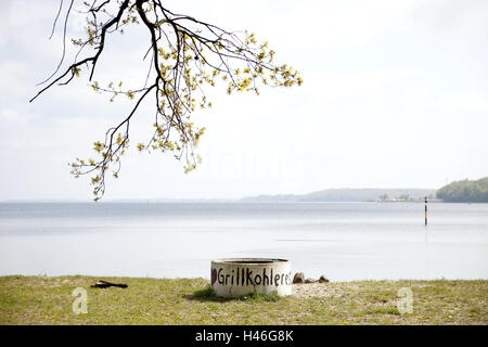 The Baltic Sea, barbecue area, nobody, outside, spring, sea, waters, tree, Förde, grill coal, grill coal leftovers, - Stock Photo