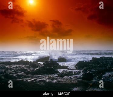 Sunset over sea rocks - Stock Photo