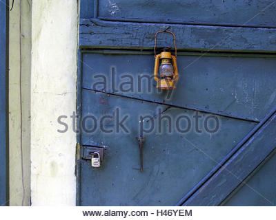 ... Yellow attack lantern hangs on nail in blue door - Stock Photo & Yellow attack lantern hangs on nail in blue door Stock Photo ...