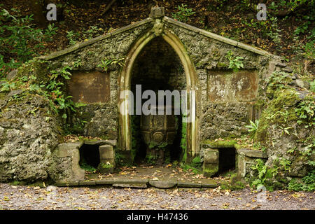 The old stone font in the gardens at Plas Newydd Llangollen home of the Ladies of Llangollen said to have been removed - Stock Photo