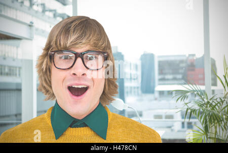 Composite image of portrait of surprised hipster businessman - Stock Photo