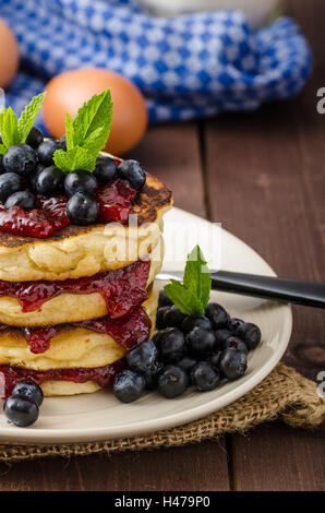Glutten-free pancakes with jam and blueberries, bio healthy ingredients, fresh mint on top - Stock Photo