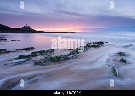 Sunrise over Mumbles Lighthouse from Bracelet Bay, Swansea, Wales, UK. Winter (December) 2014. - Stock Photo