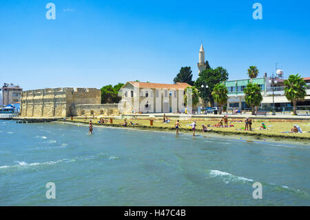 The busy Finikoudes beach next to the old castle in the city centre, Larnaca Cyprus - Stock Photo