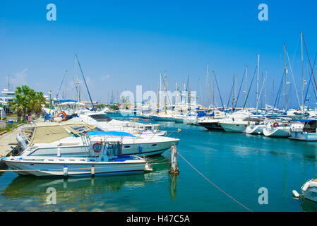 Many yachts and fishing boats are moored in Larnaca Marina, Cyprus. - Stock Photo
