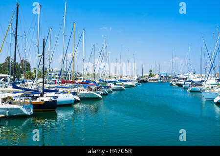 The numerous fishing boats, tourist ships and luxury yachts moored in the port of Larnaca, Cyprus. - Stock Photo