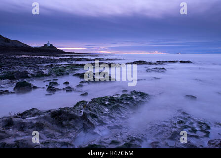 Mumbles lighthouse at dawn from Bracelet Bay, Swansea, Wales, UK. Winter (December) 2014. - Stock Photo
